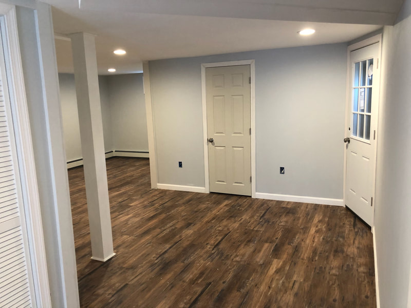 Basement renovation with new wood floors and blue paint